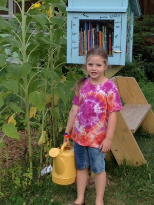 Hanging out with sunflowers and the Little Free Library.